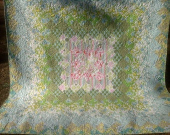 Modern Queen quilt with designer Heather Bailey fabric and pattern