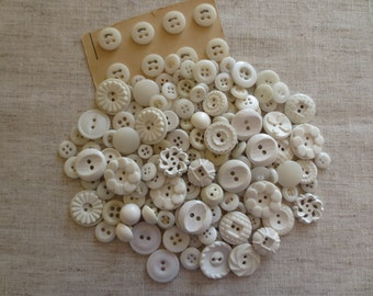 Vintage shabby chic assorted size and design white plastic sew hole and shank buttons. Lot of 170 buttons.