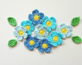 Blue flowers applique with leaves - crochet flowers decorations - spring flowers - light blue flowers with yellow centers - set of 9