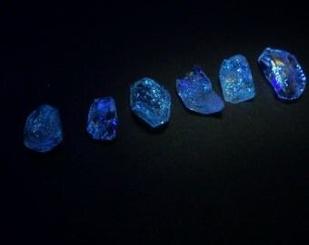 UV Quartz Crystals. Strong Blue fluorescence. Glows UV Light Hydrocarbon Petrol Inclusions Double-Terminated. 6 pc. 8.45ct 6-11 mm (QTZ586)