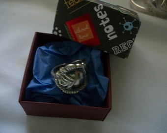 A beautiful rose ring handcrafted from vintage silverware.It comes in a handmade gift box