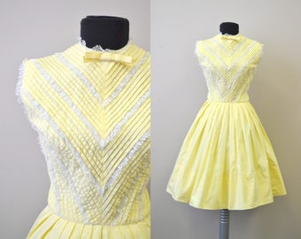 1950s Pale Yellow Pleated Dress