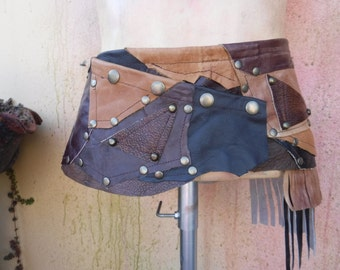 "Wildskin ,leather,  festival mini skirt ,  steampunk patchwork Leather mini skirt/belt.....36"" to 44"" hip"