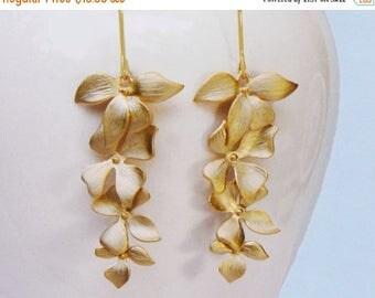 20% off. Flower earrings.   Wild Orchid flower cascade earrings in gold . four 4 orchids and a long earwire