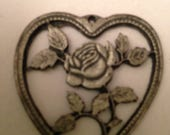 Lovely Silver Colored 1 1/2 inch Scroll Cut Rose in Heart Shaped Charm May be Pewter Or Sterling But No Identifying Marks