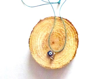 Japanese home gold plated and eye necklace on blue leather cord