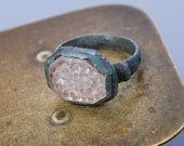 Antique metal primitive ring with glass stone heavy dark patina.