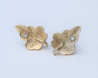 Vintage 1978 Signed Avon Radiant Leaf Gold Tone Clear Rhinestone Textured Leaves Woodland Pierced Stud Earrings