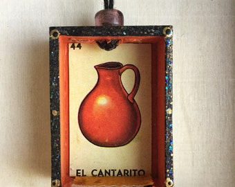 Nicho Ornament - El Cantarito. Orange and Gold with Glass Bead. Colorful glittery accents, mini serape. Loteria art.