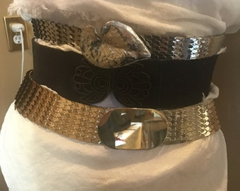 Set of 3 80s  stretch belts 2 Metal -1 black -Gold oval -1 silver leaf buckle. Size x-small-smalls.Banana Republic. Express .stretch to fit