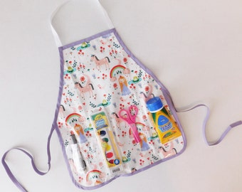 Unicorns and rainbows wipe off vinyl oil cloth school play apron smock with pockets for art supplies for messy projects  kids ages 1 - 6
