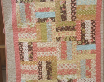 Lap to twin Quilt pieced with, beautiful Breakfast at Tiffany's by Fig tree for Moda fabrics soft pastel flowers and designs