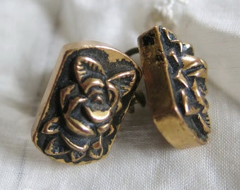 Old earrings with rose