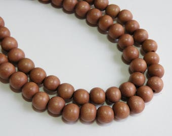Terracotta wood beads earth tones light reddish brown round 10mm full strand eco-friendly Cheesewood 1607NB