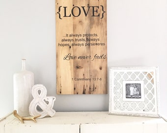 Ready to ship. Corinthians 13. love never fails. painted barn wood sign.
