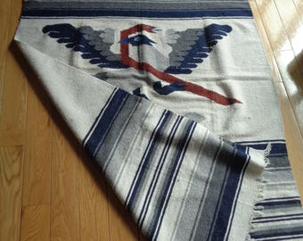 Vintage Woven Mexican Blanket in Navy Blue, White and Grey Stripe Color Palette with two  love birds entwined around each other's neck
