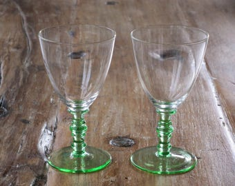 Pair of vintage green stemmed small glasses