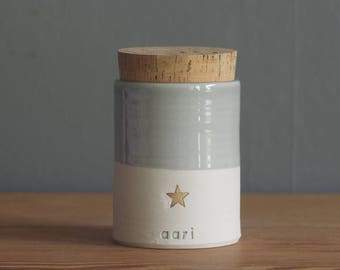 custom child size urn, baby urn, infant urn. straight shaped urn with gold star stamp shown. modern simple urn for ashes.