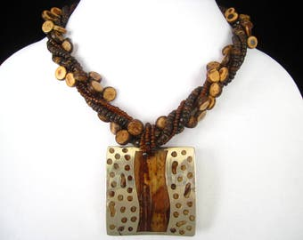 Vintage Tribal Pendant Necklace has Modern Silver Cut Out & Wood Look Pendant. 3 Wood Bead Strands, 2 Glass Bead Strands, and a Few Silvers