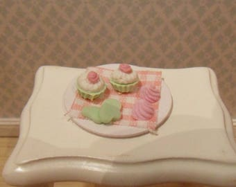 Plate with cupcakes and cookies in pastel green/pink