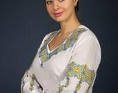 Women vyshyvanka. Traditional Ukrainian embroidered women's blouse Ethnic sorochka shirt. Ukrainian clothes. Embroidered blouse cross-stitch