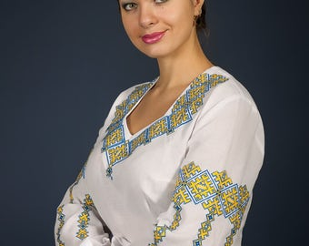Women vyshyvanka. Traditional Ukrainian embroidered women's blouse Ethnic sorochka shirt. Ukrainian clothes. Embroidered blouse cross-stitch