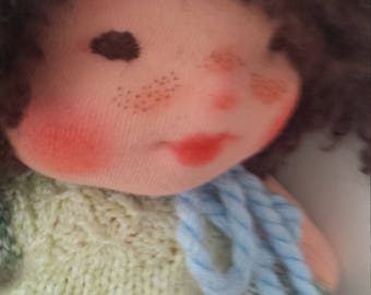 Oliver is a lovely Waldorf doll with needle felt  face, 10-12 inches tall with a blanket.