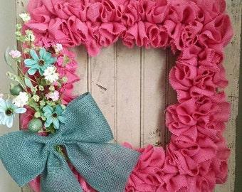 Square pink burlap wreath with blue burlap bow