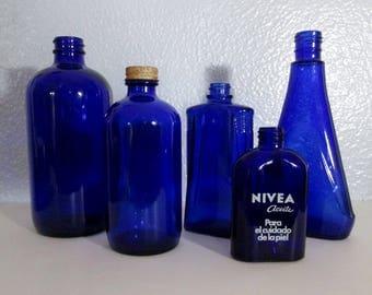 5 Vintage Embossed Cobalt Blue Bottles - Noxema Nivea Medicine Cosmetic Bottles