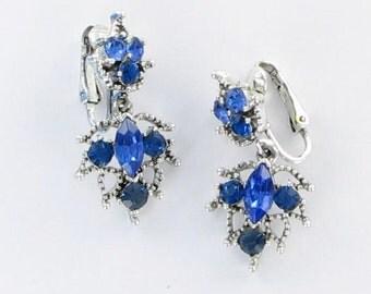 Vintage royal blue dangle rhinestone clip back earrings Silver tone bling high end polished finish 1950s