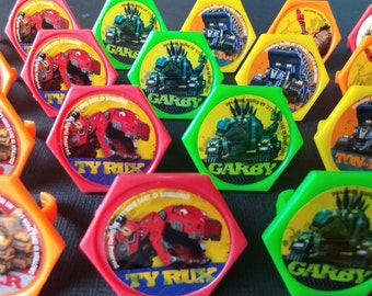 24 DINOTRUX rings for cupcake toppers cake birthday party favors goodie bags decorations decor Revitt Ty Rux D-Structs Tortool Ton-Ton Dozer