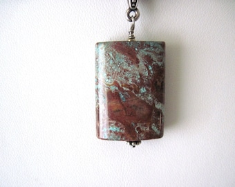 jasper pendant on leather necklace