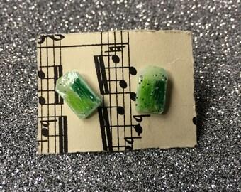 green plastic gem earrings
