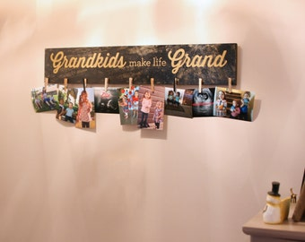 Grandkids Make Life Grand - Grandma's Photo Frame Display. Buy A Craft, Feed A Baby.