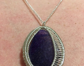 Oval wire-wrapped purple fire agate