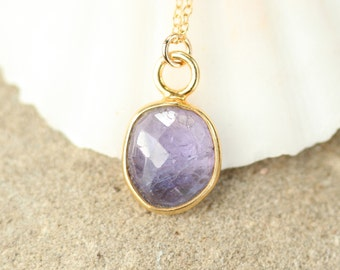 Tanzanite necklace - purple crystal necklace - A gold bezel set purple tanzanite hanging from a 14k gold filled chain