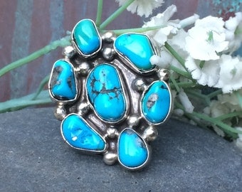 Magnificent turquoise and Sterling cluster ring  adjustable currently a size 7