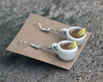 Filled tea cup earrings with lemon slice