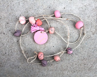 Clay hanging decor dusty pinks + purples + peaches