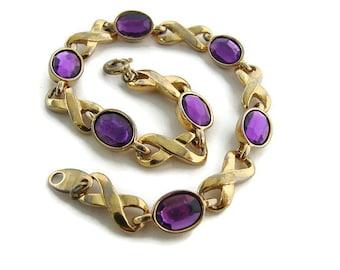 Pink gold bracelet. Pink glass bracelet. Faux Amethyst bracelet. Purple glass bracelet. Gold Avon bracelet. Infinity link bracelet.