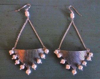 Silver And Pearl Basket Earrings are four inches long from dainty chain suspended curved silver baskets dangling silver-tipped pearls.
