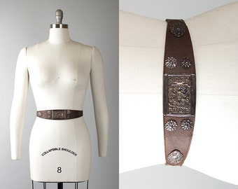 Vintage 1950s Style Cinch Belt | 80s 1980s Brown Leather Metal Floral Asymmetrical High Waist Belt (medium)