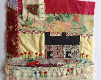 Cottages on the hill.  Textile / fibre wall art collage. Original appliqué and embroidery.