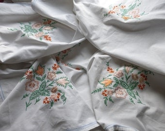 Pretty vintage hand-embroidered floral oranges and greens cotton table cloth for a tea party