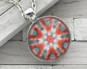 Coral and sea green abstract  kaleidoscope pendant necklace