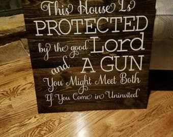 House protected by Good Lord sign