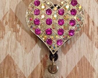 Pink heart badge reel