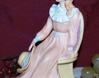 Victorian Lady In Pink W/ Blue Trim Dress Setting In Chair Holding Bonnet Statue