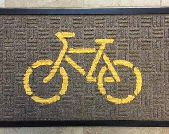 Bicycle Doormat, yellow bike on beige mat