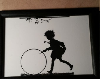 Silhouette Reproduction (copy) of a boy playing with a hoop  5 x 7